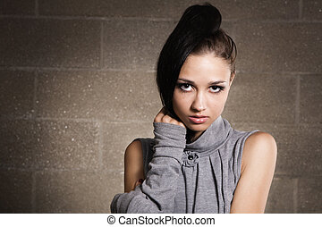Beautiful model on bricks background