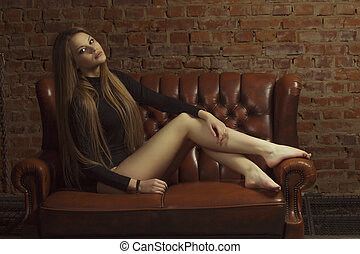 Beautiful model sitting on the couch