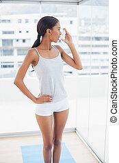 Beautiful model using her asthma atomizer