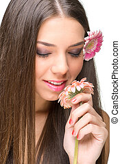 Beautiful model with flowers, eyes closed.