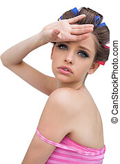 Beautiful model with hair curlers posing