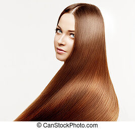 Beautiful model with healthy shiny long hair. Beauty luxurious hairstyle by stylist in salon hair care