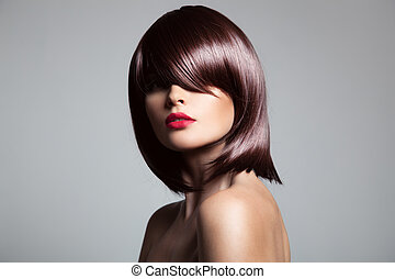 Beautiful model with perfect long glossy brown hair. Close-up po