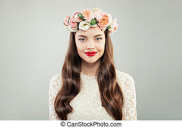 Beautiful Model Woman with Long Hair, Make up and Summer Flowers. Spring Beauty Girl, Res Lips Makeup