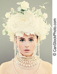 Beautiful Model Woman with Pearls and Flowers