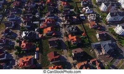 Beautiful modern city. Roofs of European houses. Private settlement. Green lake. Nice houses. Krasnodar, German village. Shot with Dji Phantom 4.