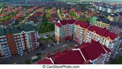 Beautiful modern city. Roofs of European houses. Private settlement. Modern houses on the background of Krasnodar, German village. Shot with Dji Phantom 4.