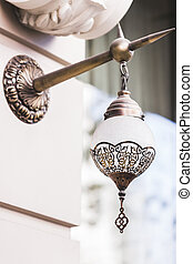 Beautiful modern metal lantern on the house wall