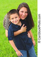 Beautiful mom hugging son