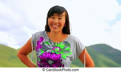 Beautiful Mongolian woman posing in landscape