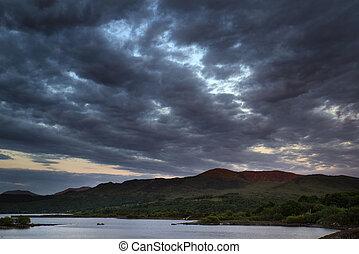 Beautiful moody sunrise over calm lake