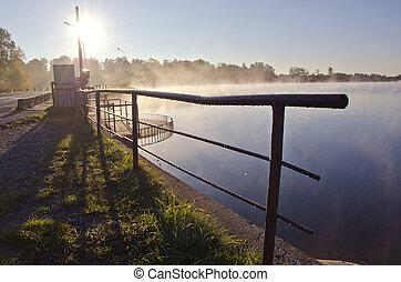 beautiful morning lake landsacpe with fence and fog
