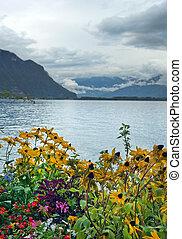 morning landscape with flowers on Lake Geneva