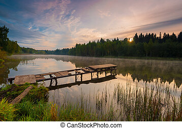 beautiful morning landscape with fog over the lake