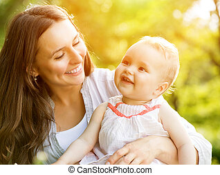 Beautiful Mother And Baby outdoors. Nature