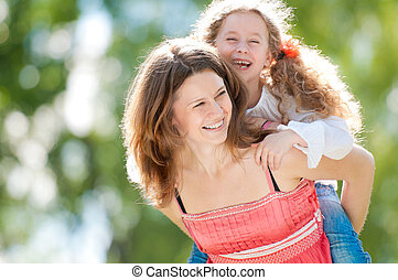 beautiful mother and daughter playing