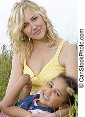 Beautiful Mother and Mixed Race African American Child In Field