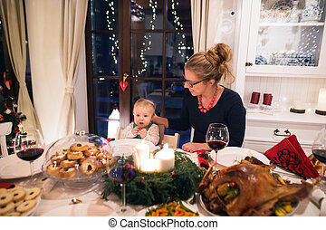 Beautiful mother and son celebrating Christmat together with the