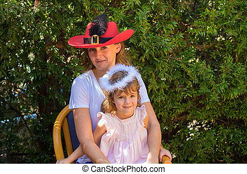 Beautiful mother in red hat and daughter