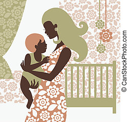 Beautiful mother silhouette with baby in children's room