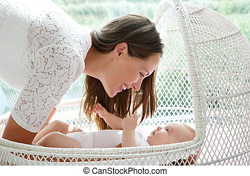 Beautiful mother smiling with cute baby