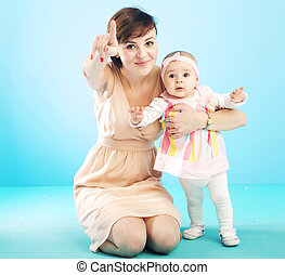 Beautiful mother with cute child