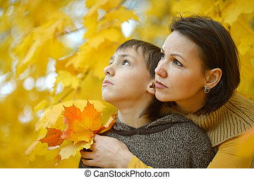 Beautiful mother with son in park
