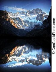 Beautiful mountain lake panorama with Dachstein Mountains