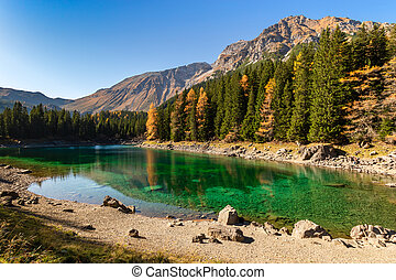 Beautiful mountain lake with green blue water. Lake Obernberg is a mountain lake located in the Stubai Alps in Tyrol, Austria.