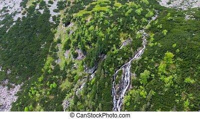 beautiful mountain lake with waterfalls