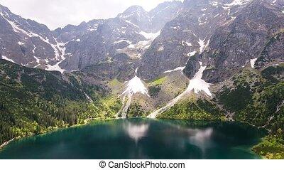 beautiful mountain lake with waterfals - beautiful aerial...