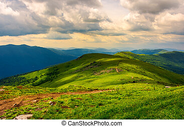 beautiful mountain landscape with grassy hills. sky with...