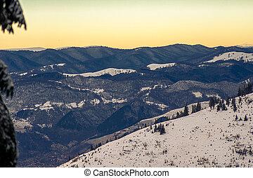 Beautiful mountain landscape with yellow sunset