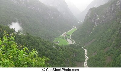 Beautiful mountain pass in mist, overview