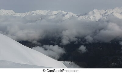 Beautiful mountain peaks of Caucasus Mountains in the clouds