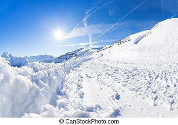 Beautiful mountain scene with snowy alpine path