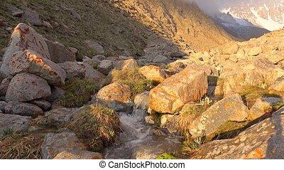 Beautiful mountain steam and orange rocks 4K shot