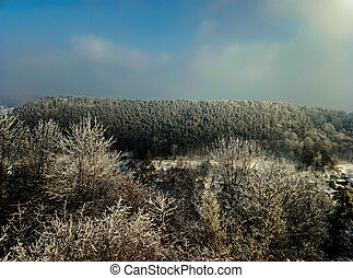 beautiful mountain view from above forest winter Kremenets mountains in Ukraine