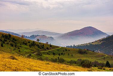 beautiful mountainous area in late autumn. foggy and...