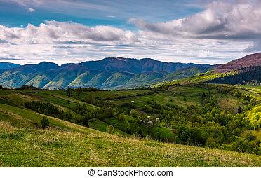 beautiful mountainous countryside in springtime. village...