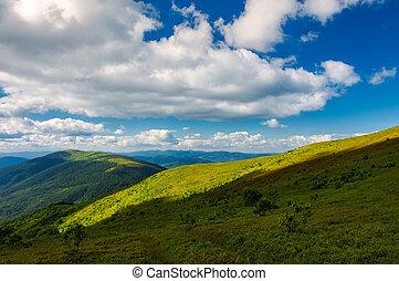 beautiful mountainous landscape under the summer sky. fluffy...