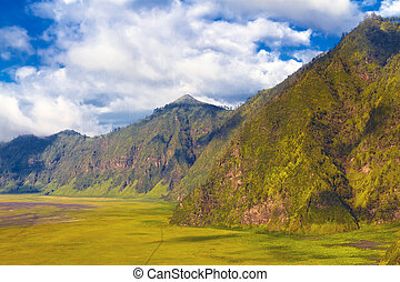 Beautiful mountains against blue sky with clouds. Bromo ...
