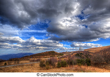 Beautiful mountains landscape and cloudy sky