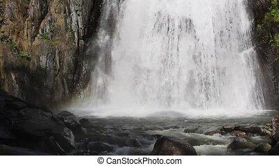 Beautiful Muehtinsky waterfall in the Altai Republic.