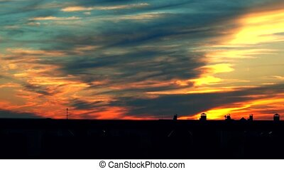 Beautiful multicolor evening sky. 4K telephoto lens shot -...