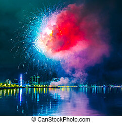 beautiful multicolored fireworks on the embankment