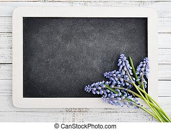 bouquet with blank blackboard