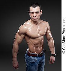 Beautiful muscular male model in jeans
