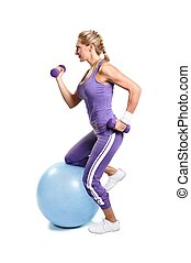 Beautiful muscular woman exercising on a white background