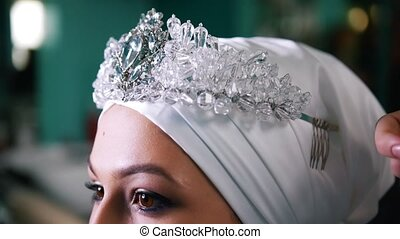 Beautiful muslim bride wearing a turban with the tiara,...